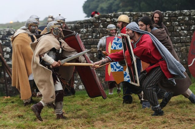 A re-enactment battle between Roman soldiers and ancient Britons at Hadrian's Wall is a reminder of the warlike past of the border (Picture: Owen Humphreys/PA)