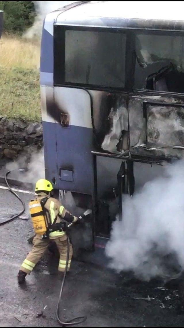 A firefighter tackling the August 2018 blaze near Denny