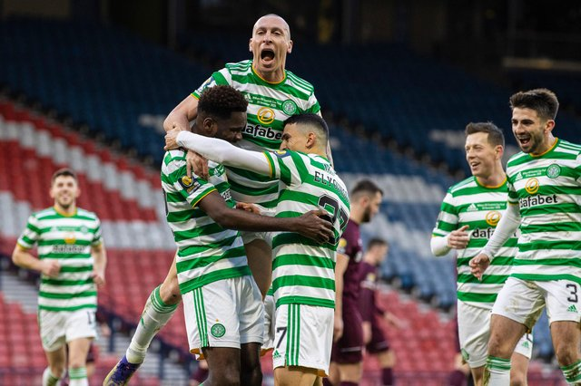 Celtic's Odsonne Edouard (left) celebrates with Scott Brown (centre) and Mohamed Elyounoussi during the William Hill Scottish Cup Final between Celtic and Hearts at Hampden Park, on December 20, 2020, in Glasgow, Scotland. (Photo by Craig Williamson / SNS Group)