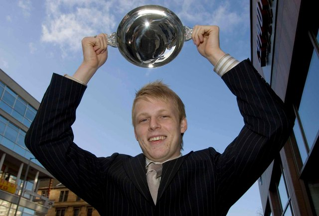 Kilmarnock striker Steven Naismith holds aloft the Scottish Football Writers Association Young Player of the Year Award for 2005/2006.