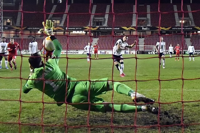 Rangers' Borna Barisic  scores a penalty kick during the UEFA Europa League game last week (Photo by DIRK WAEM/BELGA/AFP via Getty Images)