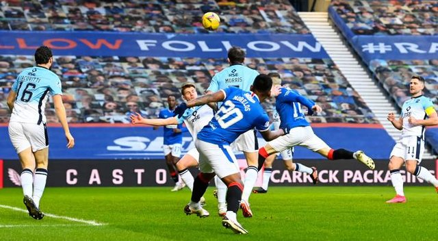 Ryan Kent heads Rangers into an early lead against Ross County at Ibrox. (Photo by Rob Casey / SNS Group)