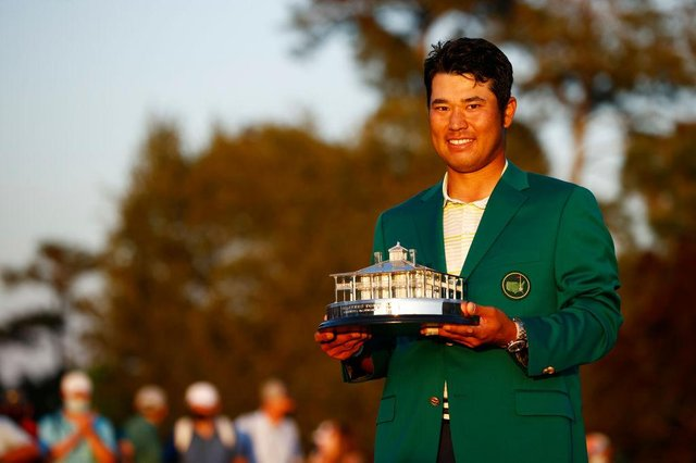 Hideki Matsuyama with the Masters Trophy during the Green Jacket Ceremony after winning the Masters at Augusta National Golf Club. Picture: Jared C. Tilton/Getty Images.