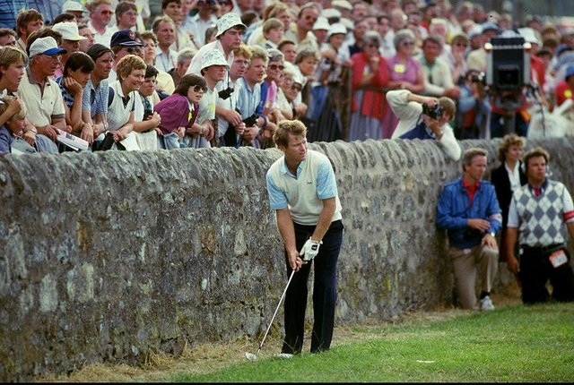 Tom Watson's hopes of winning the 1984 Open at St Andrews came unstuck when  he found himself close to the wall at the side of the 17th green in the final round. Picture: Allsport UK /Allsport.