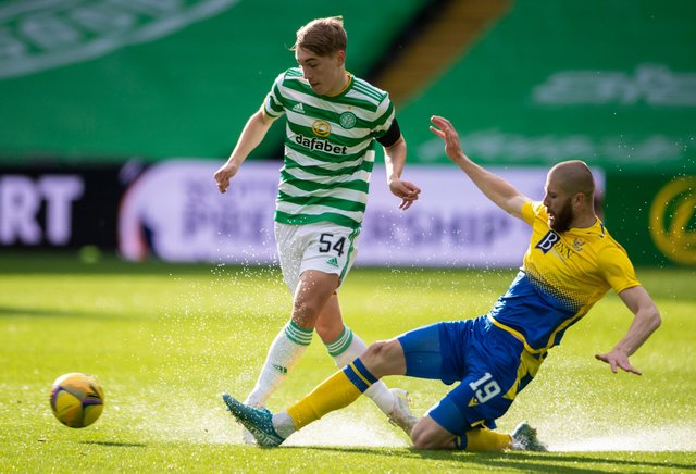 Adam Montgomery (left) evades St Johnstone's Shaun Rooney during the Celtic youngster's first-team debut on Wednesday.| (Photo by Paul Devlin / SNS Group)