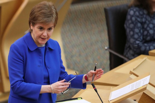 First Minister Nicola Sturgeon in the Scottish Parliament in Edinburgh to update MSPs on any changes to the Covid-19 restrictions in Scotland. Picture date: Tuesday March 16, 2021.