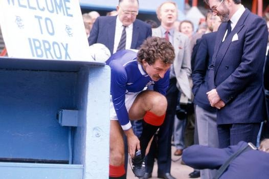 Rangers chairman John Paton (right) looks on as new player/manager Graeme Souness laces his boots before taking to the Ibrox pitch for a photocall