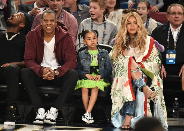 Jay Z, pictured with daughter Blue Ivy Carter and wife Beyoncé, is a huge sports fan. Picture: Theo Wargo/Getty Images