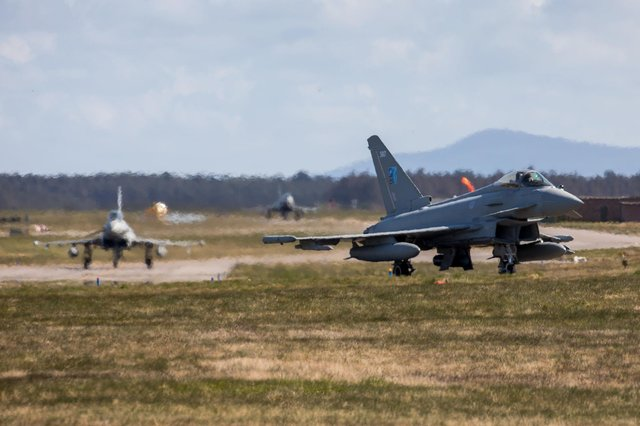 Royal Air Force Typhoons from 6 Sqn RAF Lossiemouth taxi towards the runway ready to depart  Photo credit should read: Sgt Keates/MoD