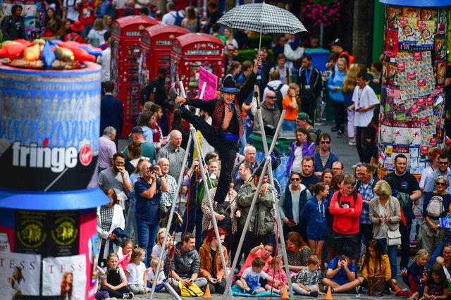 Edinburgh Festival Fringe entertainers perform on the Royal Mile. Picture: Jeff J Mitchell/Getty Images
