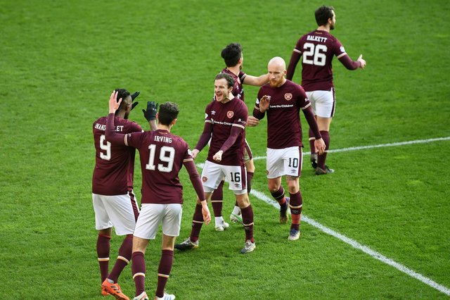Hearts striker Armand Gnanduillet celebrates his goal against Dundee with team-mates.