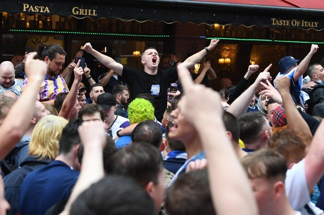 Scottish fans gather in Leicester Square in central London, ahead of the UEFA Euro 2020 match between England and Scotland at Wembley Stadium. Picture date: Friday June 18, 2021.