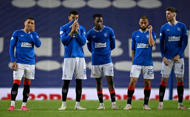 Rangers captain James Tavernier (far left) and his team-mates watch on in despair as they lose their Scottish Cup quarter-final clash with St Johnstone on penalties. Picture: SNS