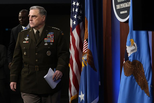 Gen. Mark Milley arrives at a news briefing at the Pentagon