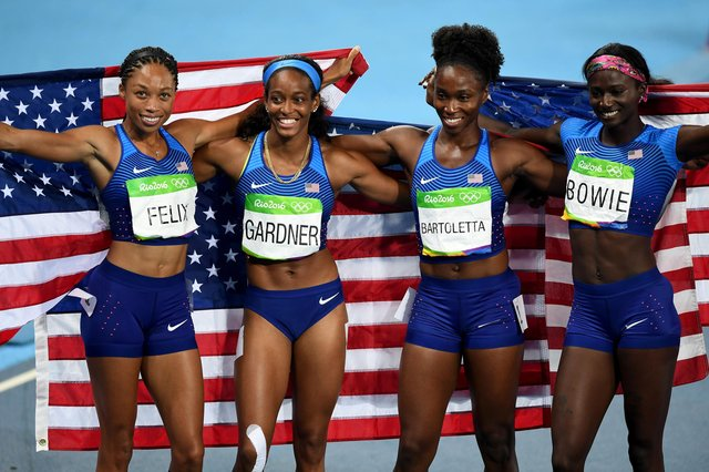 USA celebrate their victory in the women's 4x100m relay at the Rio Olympics, one of 13 gold medals won by the American track and field team at the 2016 Games.  Picture: Shaun Botterill/Getty Images