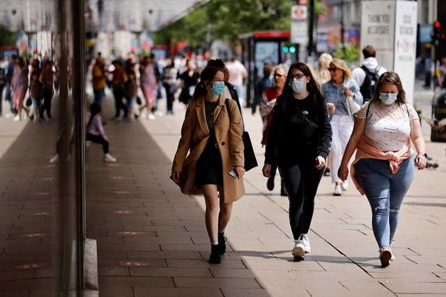 Pedestrians wearing a face mask or covering. Picture: Tolga Akmen via Getty Images