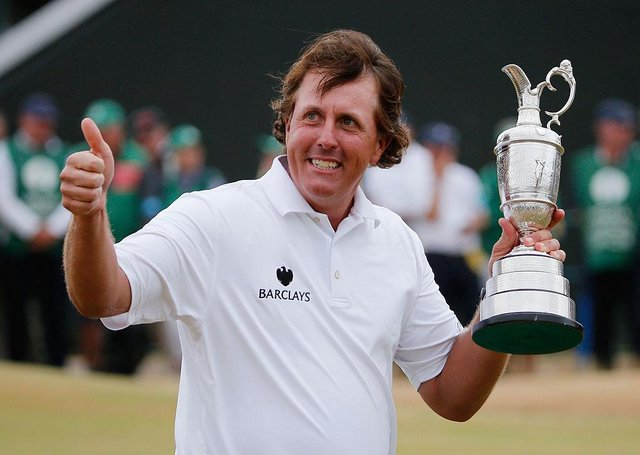 Phil Mickelson holds the Claret Jug after winning the 142nd Open Championship at Muirfield in 2013. Picture: Rob Carr/Getty Images.