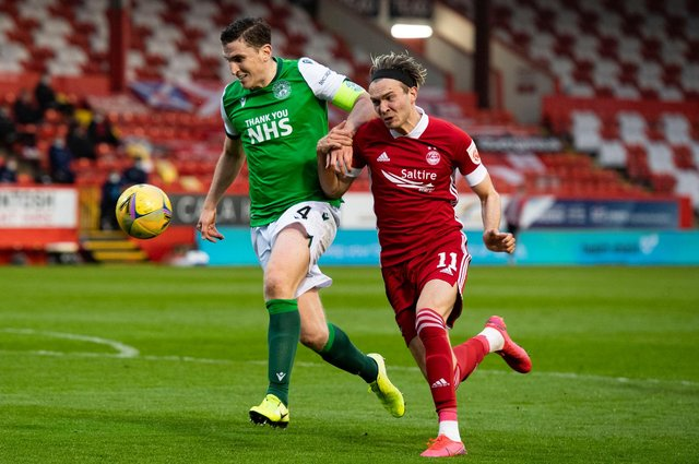 Hibs' Paul Hanlon competes with Ryan Hedges during the  match which decided the teams league fate this term. Photo by Mark Scates / SNS Group
