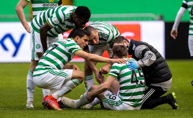James Forrest is surrounded by Celtic team-mates after pulling up in the win over Livingston. Picture: SNS