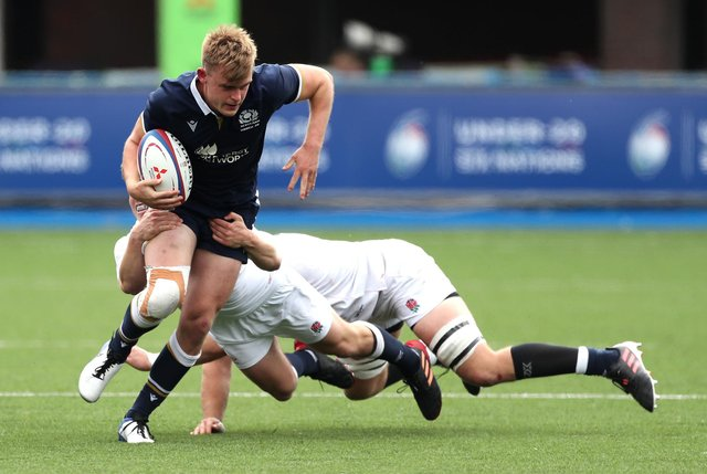 Scotland's try-scorer Christian Townsend is tackled during the Under-20 Six Nations match against England at Cardiff Arms Park. Picture: David Davies/PA Wire
