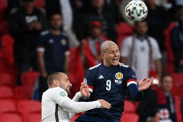 Scotland striker Lyndon Dykes leaves his mark on England defender Luke Shaw in the opening minute of the Euro 2020 Group D match at Wembley. (Photo by Andy Rain - Pool/Getty Images)