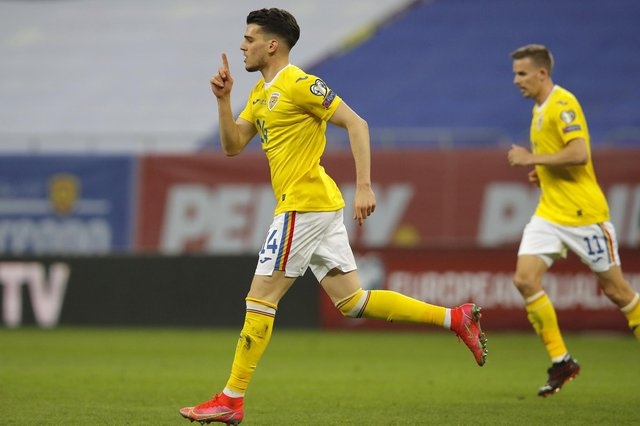 Romania's Ianis Hagi celebrates after scoring his side's third goal during the World Cup 2022 group J qualifying soccer match between Romania and North Macedonia at the National Arena stadium in Bucharest, Romania, Thursday, March 25, 2021. (AP Photo/Vadim Ghirda)