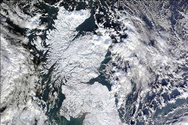 Satellite images showed how the winter snowfalls blanketed the entire country.