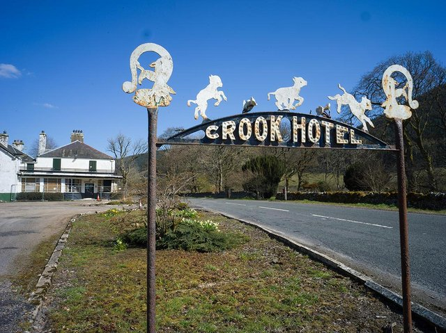 An old sign at the Crook Inn, Tweedsmuir, which will now soon dispense hospitality once again after a 15-year campaign by residents to save the pub for the community. PIC: Contributed.
