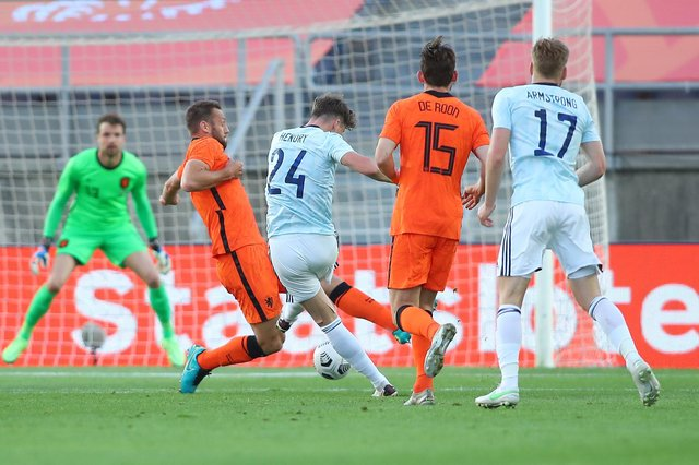 Jack Hendry strikes the opener for Scotland in the 2-2 draw with the Netherlands in Faro (Photo by Fran Santiago/Getty Images)