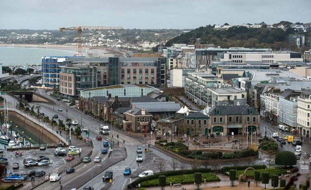 Office and residential buildings are pictured in front of the beach and seafront in St Helier, on the British island of Jersey (Photo: Oli Scarff/AFP via Getty Images).