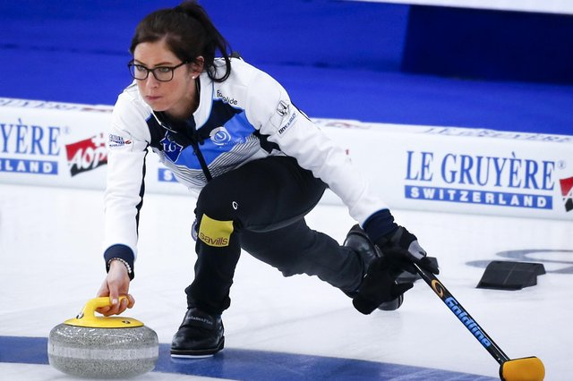 Scotland skip Eve Muirhead makes a shot against Denmark at the Women's World Curling Championship in Calgary. Picture: Jeff McIntosh/The Canadian Press via AP