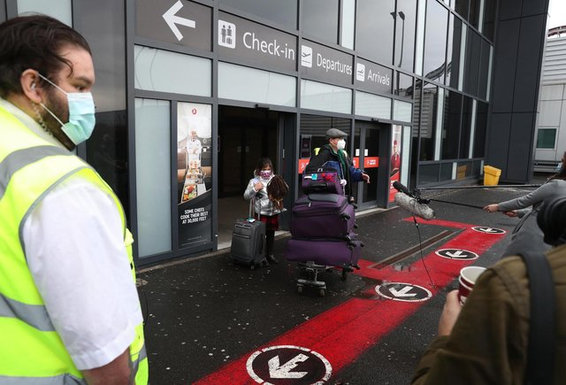 Chun Wong and his daughter Kiernan, 8, (permission given) leave Edinburgh airport after entering the country on the first day that travellers flying directly into Scotland on international flights have to self-isolate for 10 days in a quarantine hotel room.