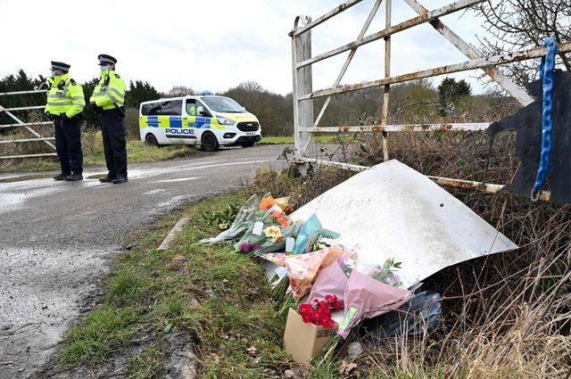 Flowers and messages of condolence for Sarah Everard left near the woodland where police officers found her remains near Ashford, southeast England (Picture: Glyn Kirk/AFP via Getty Images)