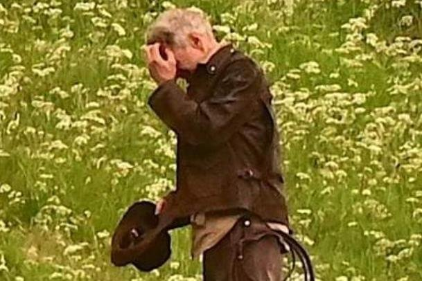 Harrison Ford, as Indiana Jones, looks as though he's fighting Borders midges in his new film, shooting at Leaderfoot Viaduct last night. Picture: Neil Renton.