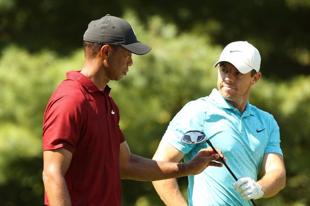 Tiger Woods and Rory McIlroy during the final round of The Northern Trust at TPC Boston in August  2020. Picture: Maddie Meyer/Getty Images.
