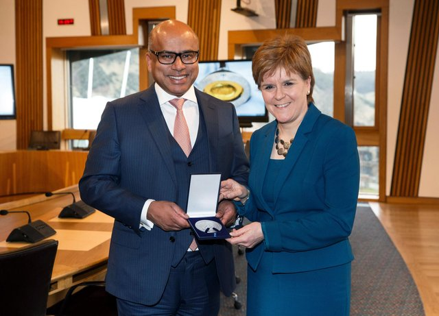 Sanjeev Gupta presents Nicola Sturgeon with a special commemorative medal cast from Lochaber aluminium in 2018, to mark two years since his group the GFG Alliance began investing in Scottish industry
