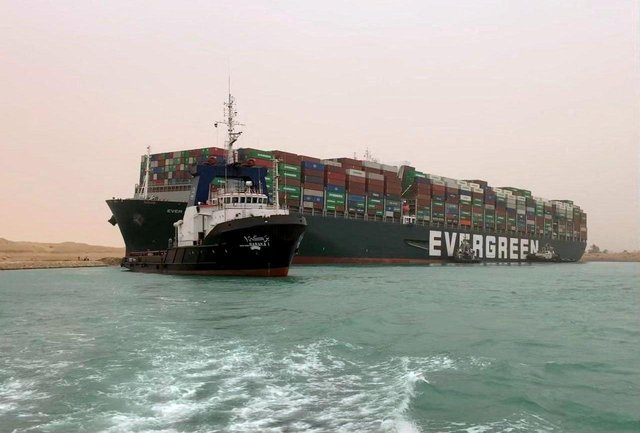 The Taiwan-owned MV Ever Given, a 400-metre- (1,300-foot-)long and 59-metre wide vessel, lodged sideways and impeding all traffic across the waterway of Egypt's Suez Canal.  (Photo: AFP via Getty Images)