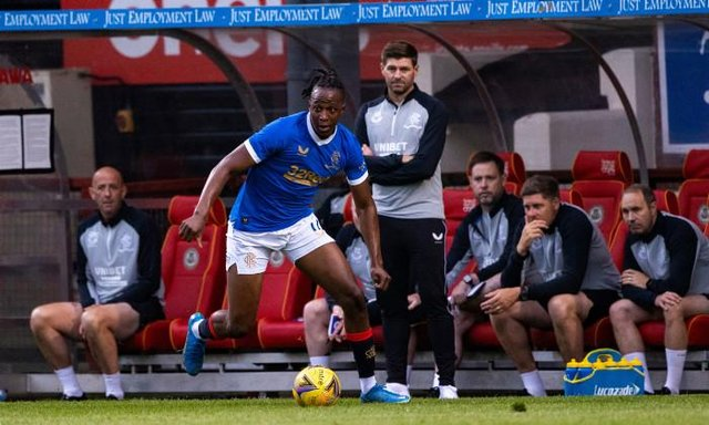 Joe Aribo in full flow for Rangers in their opening pre-season friendly against Partick Thistle at Firhill as manager Steven Gerrard looks on. (Photo by Craig Williamson / SNS Group)
