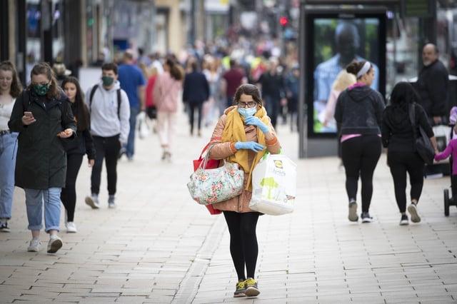 A shopper wears a protective face mask in Edinburgh's Princes Street.  Jane Barlow/PA Wire