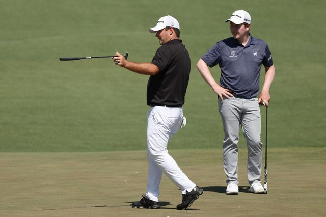 Patrick Reed, the 2018 winner, offers some advice to Bob MacIntyre on the second green during a Masters practice round on Monday at Augusta National Golf Club. Picture: Kevin C. Cox/Getty Images.