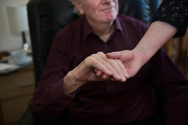 Hospice staff are still holding the hands of dying patients after handwashing by both parties (Picture: John Devlin)