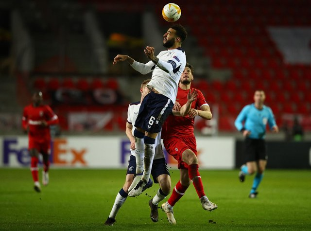 Connor Goldson leaps highest to beat Antwerp striker Felipe Avenatti to the ball during Rangers' Europa League thriller in Belgium on Thursday night. (Photo by Dean Mouhtaropoulos/Getty Images)
