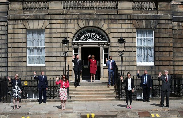 First Minister Nicola Sturgeon(c) alongside her newly formed Cabinet l-r Shona Robison, Michael Matheson, Kate Forbes, John Swinney, Humza Yousaf, Mairi Gougeon , Keith Brown and Angus Robertson on the steps of Bute House in Edinburgh.