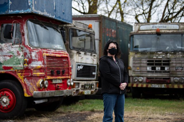 Natalie Cowie-Kayes of Mosshouse Showman's Yard in the north of Glasgow stands in front of some lorries that she and her family will be restoring over lockdown as the pandemic keeps them off the road for another summer. PIC: John Devlin.