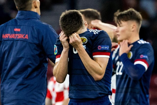Scotland's Kieran Tierney can't hide his disappointment at full time.