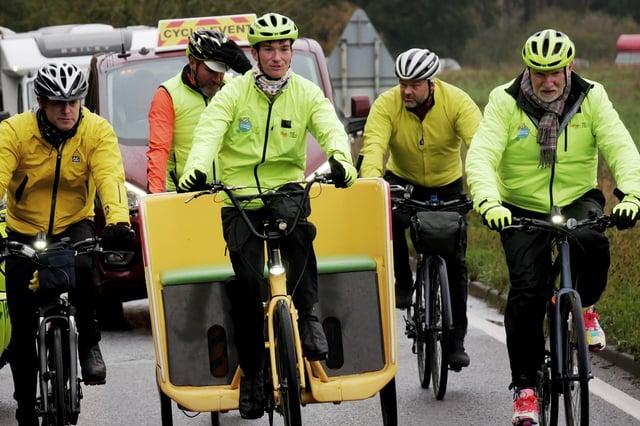 Sir Tom Hunter rides alongside presenter Matt Baker and rickshaw rider, Josh/Emma during the BBC Children in Need Rickshaw Challenge in 2019.