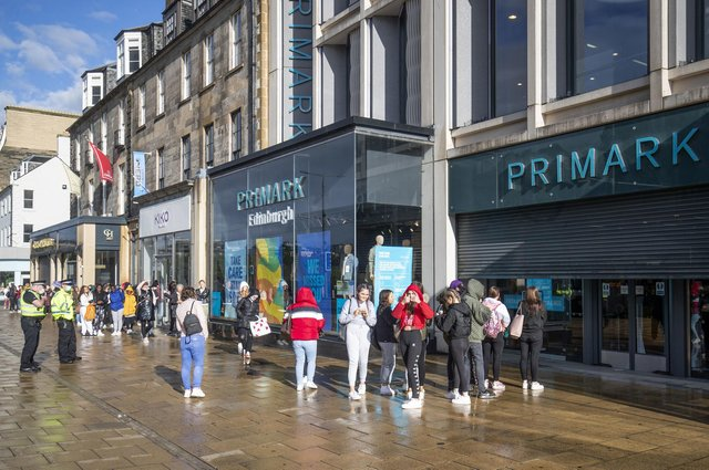 People queue outside the flagship Scottish Primark store on Princes Street in Edinburgh after it reopened following the initial spring 2020 lockdown. Picture: Jane Barlow/PA Wire