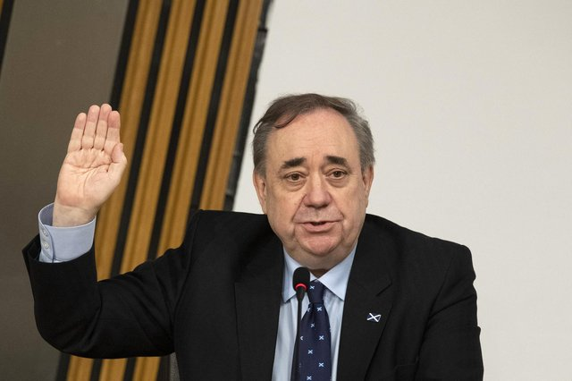 Former first minister Alex Salmond is sworn in before giving evidence to the Scottish Parliament committee examining the handling of harassment allegations him. PA Photo.