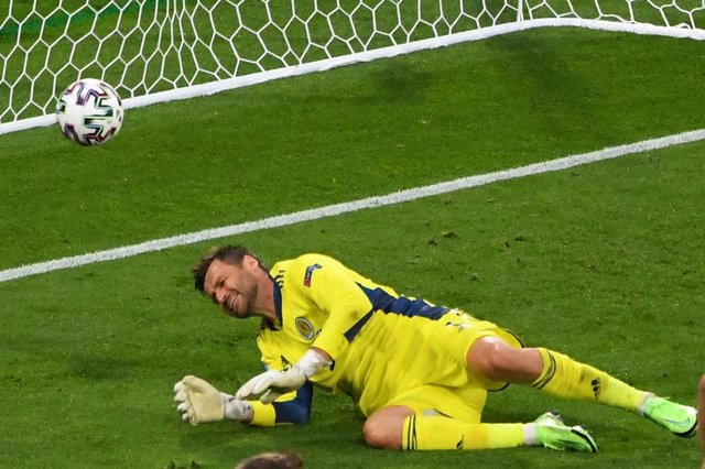 Scotland's goalkeeper David Marshall reacts after conceding a second goal during the UEFA EURO 2020 Group D football match between Croatia and Scotland at Hampden Park in Glasgow on June 22, 2021. (Photo by ANDY BUCHANAN / POOL / AFP) (Photo by ANDY BUCHANAN/POOL/AFP via Getty Images)