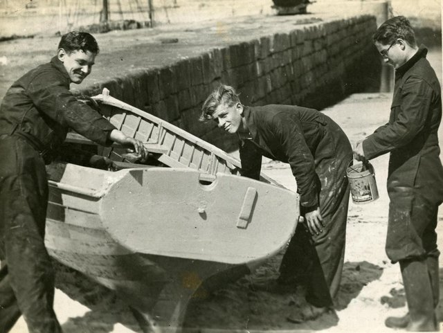 Prince Philip maintains a boat with fellow pupils at Hopeman Harbour as part of his sailing education at Gordonstoun. PIC: Gordonstoun School